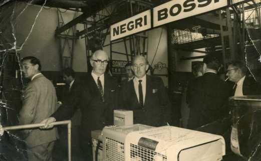 Arthur McConnell & his brother George McConnell examine an injection moulding machine in 1968
